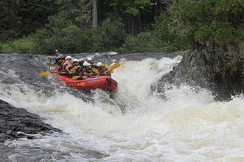 People Rafting on the Canada Falls River