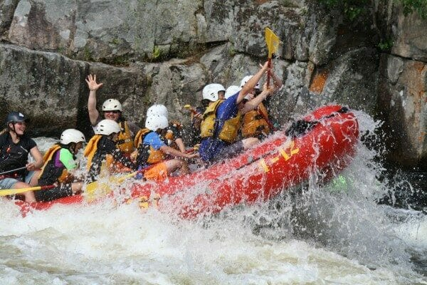 Group of People Fighting Off Waves While Whitewater Rafting on the Penobscot River