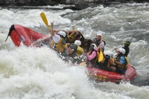 People On a Boat Going Through Rapids