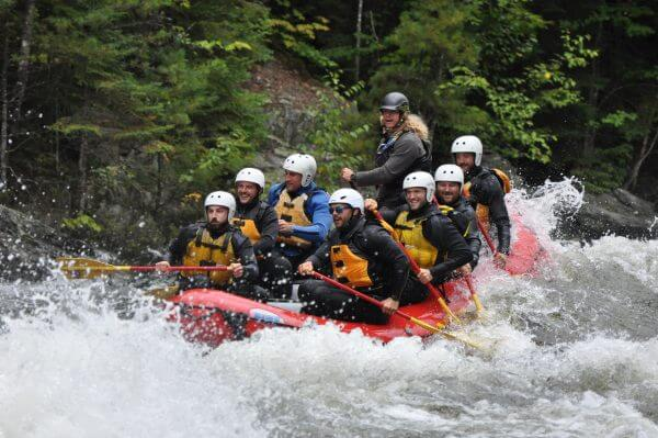 Group of people on a boat Whitewater Rafting