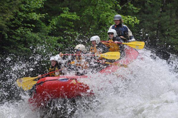 Whitewater Rafters Going Through Rough Water