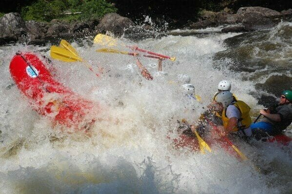 White Water Rafters Flipped Over