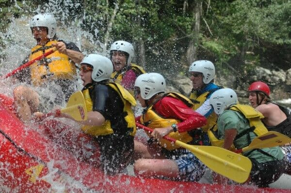 Closeup of People Whitewater Rafting