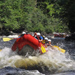 People Whitewater Rafting on the Kennebec River