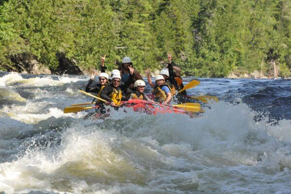 People on a boat in a whitewater river