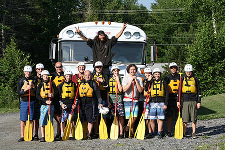 Group of Scouts With Their Rafting Gear On in Front of a Bus