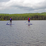 Two People Stand Up Paddle Boarding