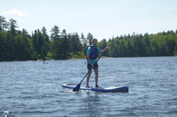 Person Paddleboarding in Maine