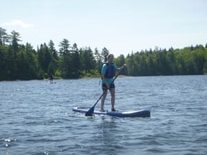 Person Paddle boarding in Maine